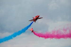 The Red Arrow synchro pair perfom a fast pass at Wings & Wheels 2012.